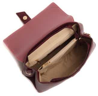 Emily | Recycled Plastic & Metals Crossbody Clutch Bag | Burgundy from GUNAS New York in Crossbody Bags, Bags