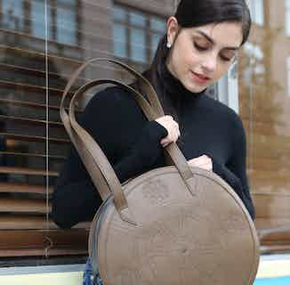 Meghan | Vegan Leather Women's Round Tote Bag | Brown from GUNAS New York in Totes Shoppers, Bags