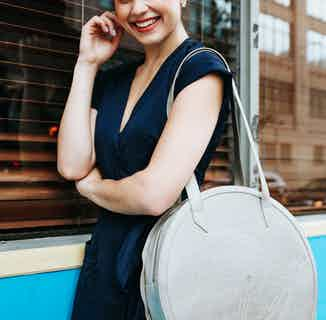 Meghan   Vegan Leather Women's Round Tote Bag   Silver from GUNAS New York in Totes Shoppers, Bags